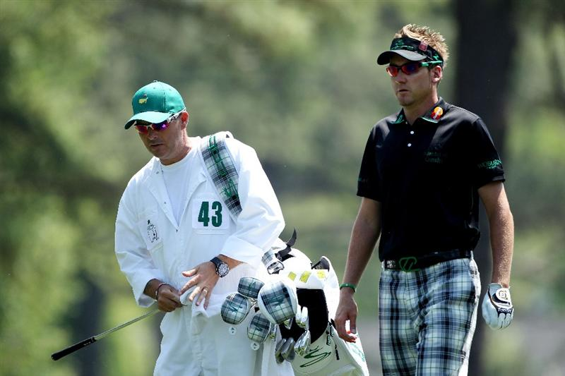 AUGUSTA, GA - APRIL 10:  Ian Poulter of England  walks with his caddie Terry Mundy to the first green during the final round of the 2011 Masters Tournament at Augusta National Golf Club on April 10, 2011 in Augusta, Georgia.  (Photo by Andrew Redington/Getty Images)