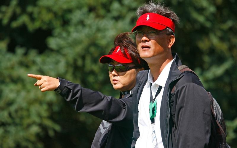 SUGAR GROVE, IL - AUGUST 20:  (L-R) Bo and B.J. Wie watch the play of the U.S. Team during a practice round prior to the start of the 2009 Solheim Cup at Rich Harvest Farms on August 20, 2009 in Sugar Grove, Illinois.  (Photo by Scott Halleran/Getty Images)