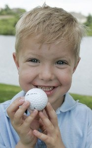 Grant Rieler, 4, was given a golf ball from Fuzzy Zoeller in the third and final round of the Allianz Championship held at Glen Oaks Country Club in West Des Moines, IA, on June 4, 2006.Photo by: Stan Badz/PGA TOUR