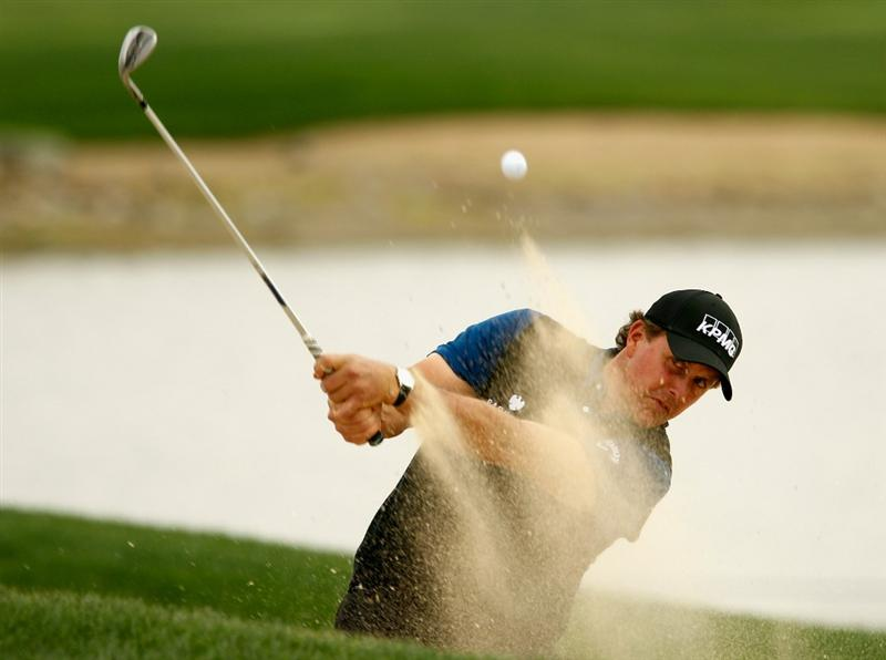 ABU DHABI, UNITED ARAB EMIRATES - JANUARY 20:  Phil Mickelson of the USA plays a bunker shot on the ninth hole during the first round of the 2011 Abu Dhabi HSBC Golf Championship at the Abu Dhabi Golf Club on January 20, 2011 in Abu Dhabi, United Arab Emirates.  (Photo by Scott Halleran/Getty Images)