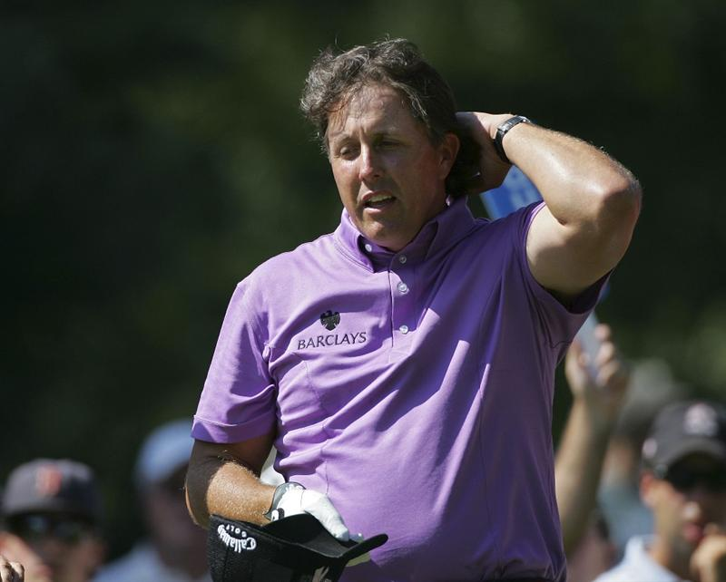NORTON, MA - SEPTEMBER 04:  Phil Mickelson of the United States reacts to an errant drive during the first round of the Deutsche Bank Championship at TPC Boston held on September 4, 2009 in Norton, Massachusetts.  (Photo by Michael Cohen/Getty Images)