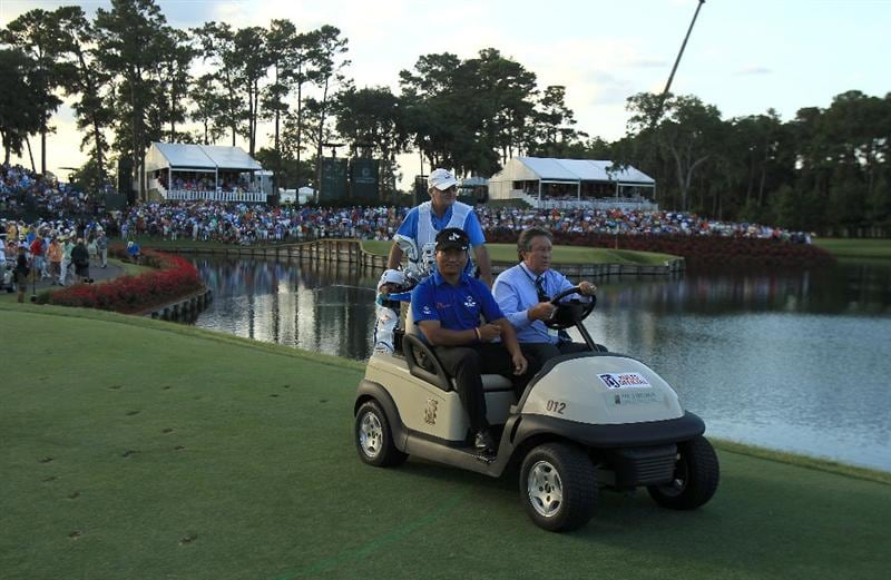 PONTE VEDRA BEACH, FL - MAY 15:  K.J. Choi of South Korea is driven in a golf cart to the first playoff hole during the final round of THE PLAYERS Championship held at THE PLAYERS Stadium course at TPC Sawgrass on May 15, 2011 in Ponte Vedra Beach, Florida.  (Photo by Streeter Lecka/Getty Images)