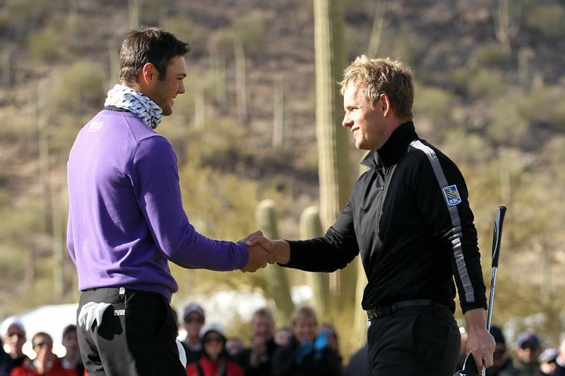 MARANA, AZ - FEBRUARY 27:  (L-R) Martin Kaymer of Germany congratulates Luke Donald of England on his victory on the 16th hole during the final round of the Accenture Match Play Championship at the Ritz-Carlton Golf Club on February 27, 2011 in Marana, Arizona.  (Photo by Andy Lyons/Getty Images)