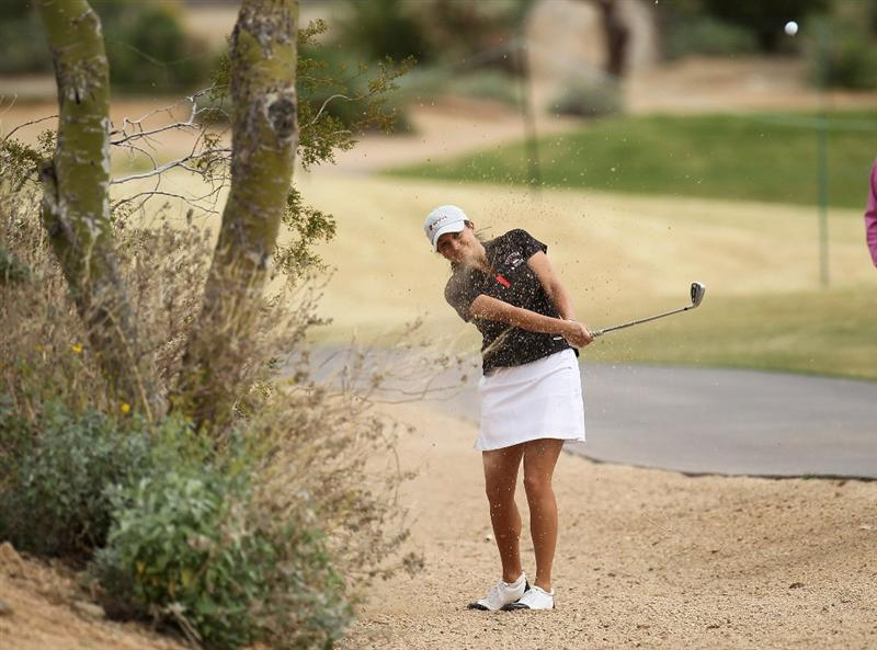 PHOENIX, AZ - MARCH 20:  Dori Carter hits from off the fairway on the seventh hole during the final round of the RR Donnelley LPGA Founders Cup at Wildfire Golf Club on March 20, 2011 in Phoenix, Arizona.  (Photo by Stephen Dunn/Getty Images)