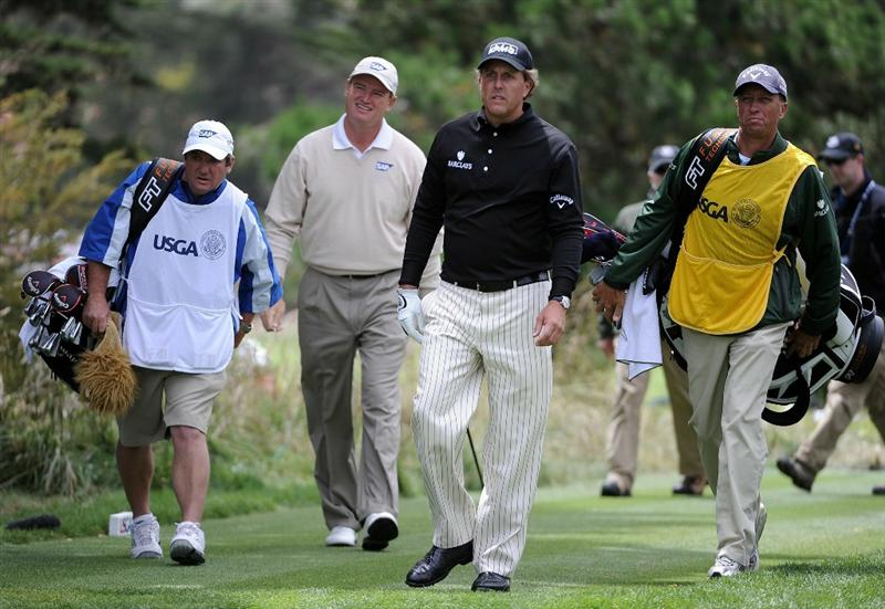 PEBBLE BEACH, CA - JUNE 20:  Ernie Els of South Africa (2nd-L) walks with Phil Mickelson (2nd-R) and their caddies on the second hole during the final round of the 110th U.S. Open at Pebble Beach Golf Links on June 20, 2010 in Pebble Beach, California.  (Photo by Harry How/Getty Images)