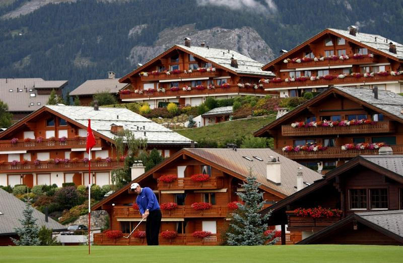 CRANS, SWITZERLAND - SEPTEMBER 04:  Paul McGinley of Ireland plays a chip shot on the 14th hole during the second round of The Omega European Masters at Crans-Sur-Sierre Golf Club on September 4, 2009 in Crans Montana, Switzerland.  (Photo by Andrew Redington/Getty Images)