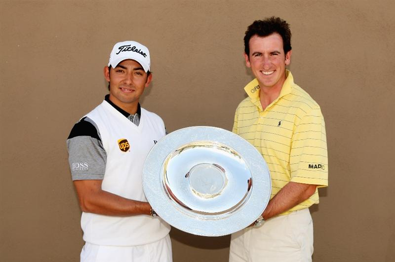 GIRONA, SPAIN - APRIL 29:  Pablo Larrazabal of Spain (L) is presented with the Sir Henry Cotton Rookie of the Year award by fellow countryman Gonzalo Fernandez-Castano prior to the start of the Open de Espana at the PGA Golf Catalunya on April 29, 2009 in Girona, Spain.  (Photo by Warren Little/Getty Images)