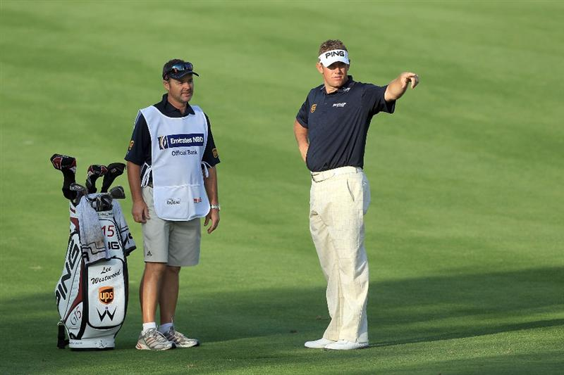 DUBAI, UNITED ARAB EMIRATES - FEBRUARY 03:  Lee Westwood of England prepares to play his second shot at the 14th hole with the assistance of his caddie Billy Foster of England during the pro-am as a preview for the 2010 Omega Dubai Desert Classic on the Majilis Course at the Emirates Golf Club on February 3, 2010 in Dubai, United Arab Emirates.  (Photo by David Cannon/Getty Images)