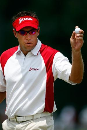 PONTE VEDRA BEACH, FL - MAY 10:  Brian Davis of England holds up his ball after putting on the second hole during the final round of THE PLAYERS Championship on THE PLAYERS Stadium Course at TPC Sawgrass on May 10, 2009 in Ponte Vedra Beach, Florida.  (Photo by Jamie Squire/Getty Images)
