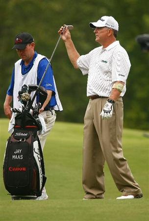 CONOVER, NC - SEPTEMBER 20:  Jay Haas pulls a club alongside his caddie Tommy Lamb on the 16th hole during the final round of the Greater Hickory Classic at the Rock Barn Golf & Spa on September 20, 2009 in Conover, North Carolina.  (Photo by Scott Halleran/Getty Images)
