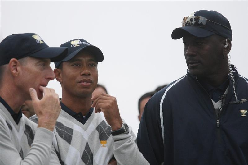 SAN FRANCISCO - OCTOBER 10:  Tiger Woods of the USA Team stands with the Team Assistant Michael Jordan during the Day Three Afternoon Fourball Matches of The Presidents Cup at Harding Park Golf Course on October 10, 2009 in San Francisco, California.  (Photo by Warren Little/Getty Images)