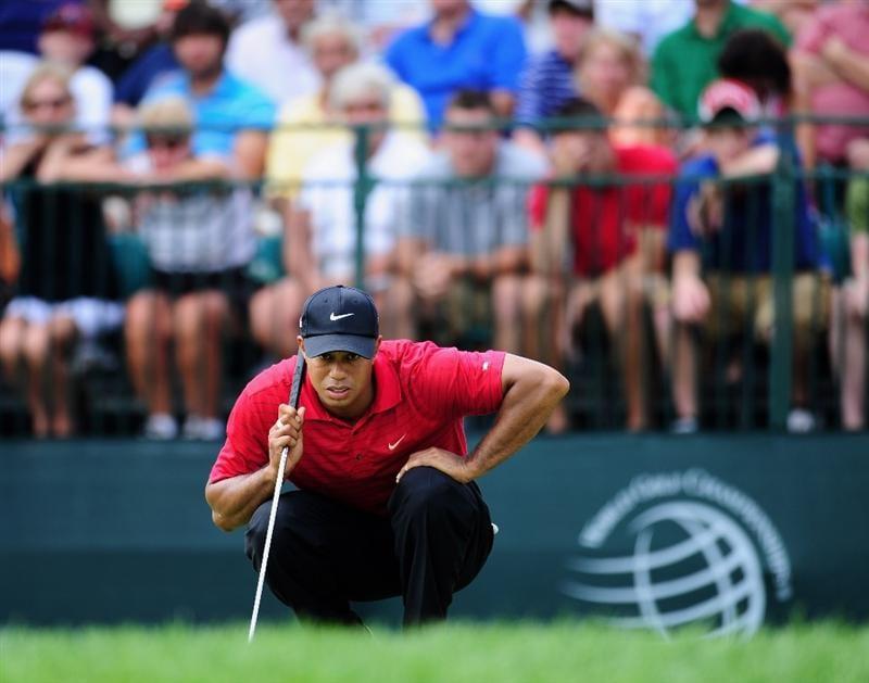 AKRON, OH - AUGUST 09:  Tiger Woods of USA lines up his putt on the nineth hole during the final round of the World Golf Championship Bridgestone Invitational on August 9, 2009 at Firestone Country Club in Akron, Ohio.  (Photo by Stuart Franklin/Getty Images)