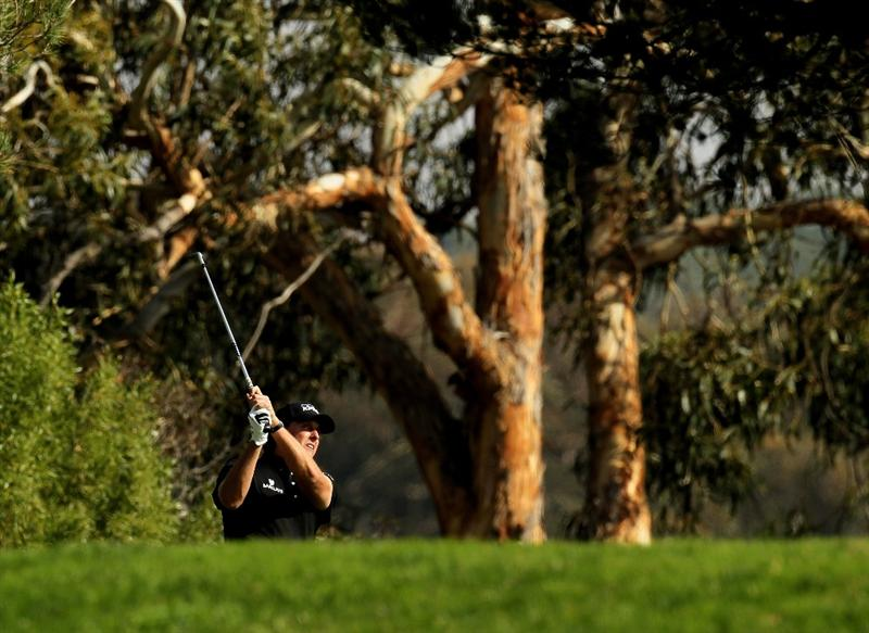 LA JOLLA, CA - JANUARY 29:  Phil Mickelson from the trees on the fifth hole at the North Course at Torrey Pines Golf Course during the second round of the Farmers Insurance Open on January 29, 2010 in La Jolla, California.  (Photo by Stephen Dunn/Getty Images)