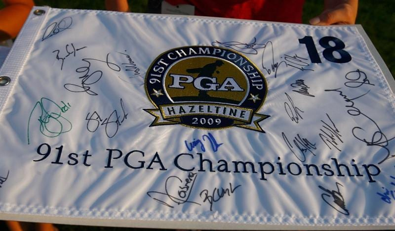 CHASKA, MN - AUGUST 11:  A fan holds a PGA Championship banner while waiting for autographs during the second preview day of the 91st PGA Championship at Hazeltine Golf Club on August 11, 2009 in Chaska, Minnesota.  (Photo by Scott Halleran/Getty Images)