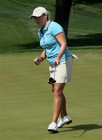 RANCHO MIRAGE, CA - APRIL 02:  Cristie Kerr pumps her fist after making a birdie putt on the 10th hole during the second round of the Kraft Nabisco Championship at Mission Hills Country Club on April 2, 2010 in Rancho Mirage, California.  (Photo by Stephen Dunn/Getty Images)
