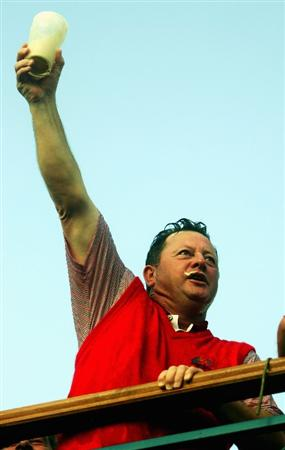 KILDARE, IRELAND - SEPTEMBER 24:   European Team Captain Ian Woosnam celebrates by downing a pint of Guinness on the clubhouse balcony after Europe win the Ryder Cup by a score of 18 1/2 - 9 1/2 on the final day of the 2006 Ryder Cup at The K Club on September 24, 2006 in Straffan, Co. Kildare, Ireland.  (Photo by Donald Miralle/Getty Images)