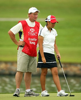 SINGAPORE - FEBRUARY 29:  Amelia Yong of Singapore and her caddie line up a putt on the 11th hole during the second round of the HSBC Women's Champions at Tanah Merah Country Club on February 29, 2008 in Singapore.  (Photo by Andrew Redington/Getty Images)