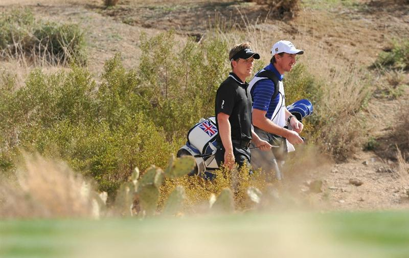 MARANA, AZ - FEBRUARY 25:  Luke Donald and caddie John McLaren walk during the third round of the Accenture Match Play Championship at the Ritz-Carlton Golf Club on February 25, 2011 in Marana, Arizona.  (Photo by Stuart Franklin/Getty Images)