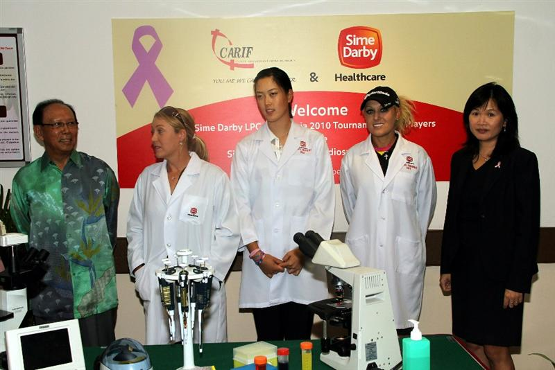 KUALA LUMPUR, MALAYSIA - OCTOBER 19 : (L-R) Sime Darby Chairman Tun Musa Hitam, Cristie Kerr, Michelle Wie, Natalie Gulbis of USA and Prof. Dr Teo Soo-Hwang of the Subang Medical Centre pose for photographs during the Sime Darby LPGA Charity visit to the Subang Medical Centre on October 19, 2010 in Kuala Lumpur, Malaysia (Photo by Stanley Chou/Getty Images)