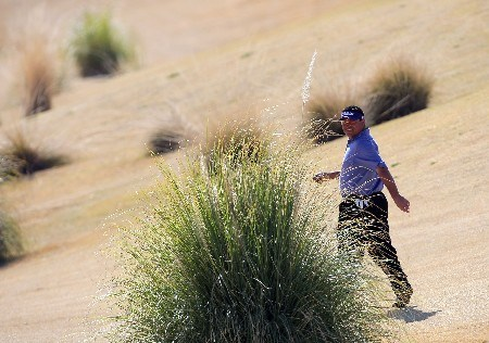 PALM DESERT, CA - JANUARY 20:  Robert Gamez searches for his ball in the rough on the fifth hole during the fifth round of the 49th Bob Hope Chrysler Classic at the Classic Club Course on January 20, 2008 in Palm Desert, California.  (Photo by Harry How/Getty Images)