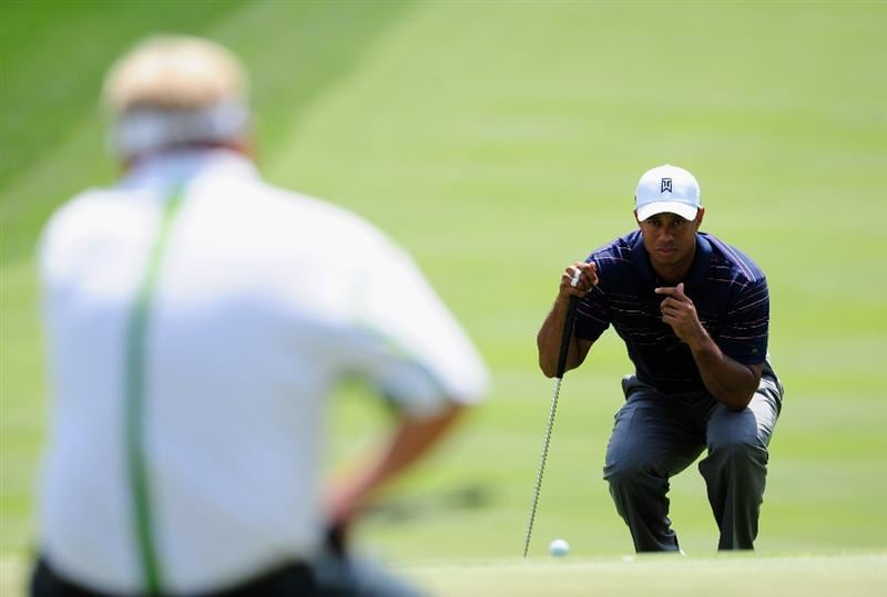 AKRON, OH - AUGUST 07:  Tiger Woods of USA lines up his putt on the ninth hole during the second round of the World Golf Championship Bridgestone Invitational on August 7, 2009 at Firestone Country Club in Akron, Ohio.  (Photo by Stuart Franklin/Getty Images)
