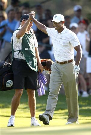 GRAND BLANC, MI - JULY 31: Tiger Woods high fives his caddie Steve Williams after chipping in for eagle  on the 12th hole during the second round of the Buick Open at Warwick Hills Golf and Country Club on July 31, 2009 in Grand Blanc, Michigan.  (Photo by Gregory Shamus/Getty Images)