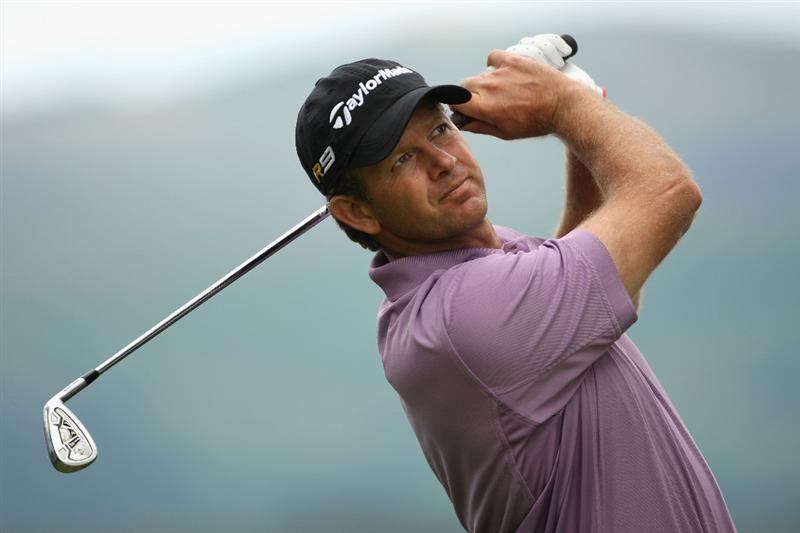 LUSS, UNITED KINGDOM - JULY 08:  Retief Goosen of South Africa hits an iron shot during the Pro Am prior to The Barclays Scottish Open at Loch Lomond Golf Club on July 08, 2009 in Luss, Scotland. (Photo by Andrew Redington/Getty Images)
