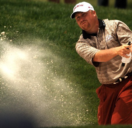 John Rollins hits out of a bunker on the fourth green during the final round of the 2005 EDS Byron Nelson Championship at TPC Los Colinas in Los Colinas, Texas May 15, 2005.Photo by Steve Grayson/WireImage.com