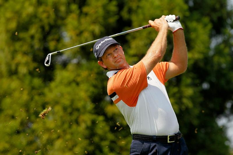 ATLANTA - SEPTEMBER 23:  Retief Goosen of South Africa hits his tee shot on the second hole during the first round of THE TOUR Championship presented by Coca-Cola at East Lake Golf Club on September 23, 2010 in Atlanta, Georgia.  (Photo by Kevin C. Cox/Getty Images)