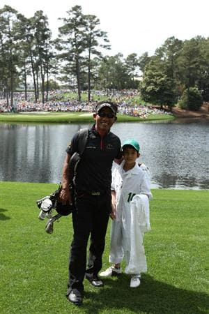 AUGUSTA, GA - APRIL 07:  Thongchai Jaidee of Thailand poses with his caddie during the Par 3 Contest prior to the 2010 Masters Tournament at Augusta National Golf Club on April 7, 2010 in Augusta, Georgia.  (Photo by Andrew Redington/Getty Images)