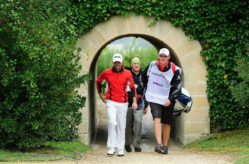 PARIS - SEPTEMBER 24:  John Parry of England and Pelle Edberg of Sweden walk through a tunnel during the second round of the Vivendi cup at Golf de Joyenval on September 24, 2010 in Chambourcy, near Paris, France.  (Photo by Stuart Franklin/Getty Images)