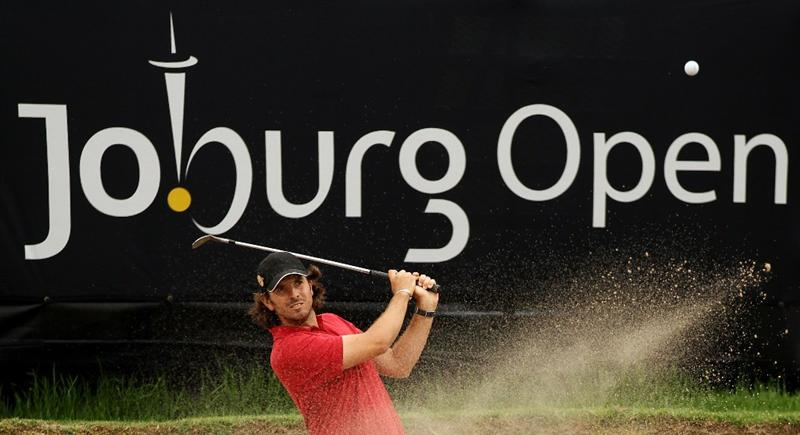 JOHANNESBURG, SOUTH AFRICA - JANUARY 15:  Thomas AIken of South Africa plays out of the 16th greenside bunker during the third round of the Joburg Open at Royal Johannesburg and Kensington Golf Club on January 15, 2011 in Johannesburg, South Africa.  (Photo by Warren Little/Getty Images)