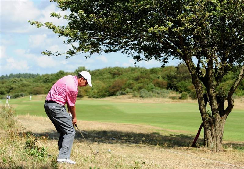 ZANDVOORT, NETHERLANDS - AUGUST 21:  Peter Lawrie of Ireland plays his approach shot on the second hole during the second round of The KLM Open at Kennemer Golf & Country Club on August 21, 2009 in Zandvoort, Netherlands.  (Photo by Stuart Franklin/Getty Images)
