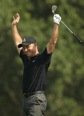 NEW DELHI, INDIA - FEBRUARY 20:  Robert Coles of England celebrates a shot on the 7th hole competes during the fourth round of the Avantha Masters held at The DLF Golf and Country Club on February 20, 2011 in New Delhi, India.  (Photo by Ian Walton/Getty Images)