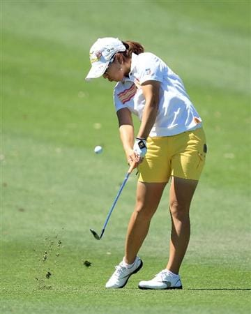 RANCHO MIRAGE, CA - MARCH 31:  Mika Miyazato of Japan plays her third shot on the 9th hole during the first round of the 2011 Kraft Nabisco Championship on the Dinah Shore Championship Course at the Mission Hills Country Club on March 31, 2011 in Rancho Mirage, California.  (Photo by David Cannon/Getty Images)