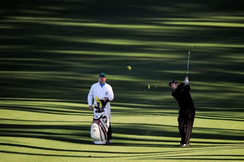 AUGUSTA, GA - APRIL 06:  Kevin Streelman hits a shot as his caddie Michael Christensen looks on during a practice round prior to the 2011 Masters Tournament at Augusta National Golf Club on April 6, 2011 in Augusta, Georgia.  (Photo by Harry How/Getty Images)