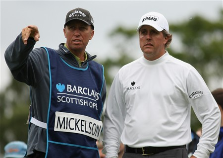 LUSS, UNITED KINGDOM - JULY 12:  Phil Mickelson of USA lines up a shot with caddy Jim Mackay during the Third Round of The Barclays Scottish Open at Loch Lomond Golf Club on July 12, 2008 in Luss, Scotland.  (Photo by Warren Little/Getty Images)