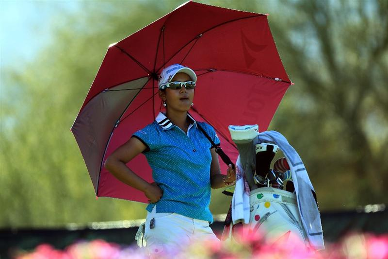 RANCHO MIRAGE, CA - MARCH 31:  Ai Miyazato of Japan waits to play her tee shot at the par 3, 8th hole during the first round of the 2011 Kraft Nabisco Championship on the Dinah Shore Championship Course at the Mission Hills Country Club on March 31, 2011 in Rancho Mirage, California.  (Photo by David Cannon/Getty Images)