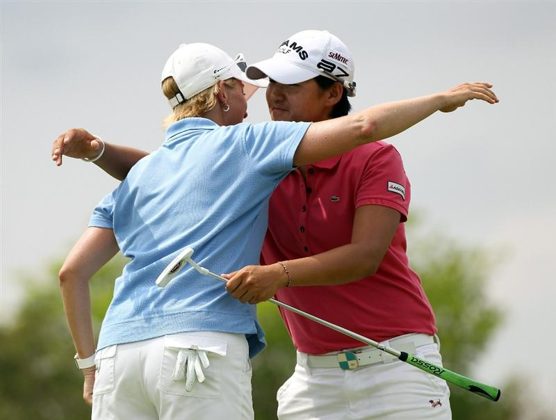 SINGAPORE - FEBRUARY 27:  Karrie Webb of Australia is congratulated by Yani Tseng of Taiwan during the final round of the HSBC Women's Champions at Tanah Merah Country Club  on February 27, 2011 in Singapore, Singapore.  (Photo by Ross Kinnaird/Getty Images)