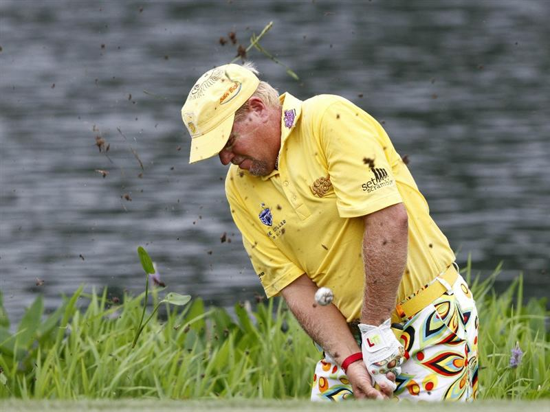 MEMPHIS, TN - JUNE 11: John Daly of the United States chips onto the 9th green during the second round of the St. Jude Classic at TPC Southwind held on June 11, 2010 in Memphis, Tennessee. Daly later had to take a drop after learning he had the wrong golfball.  (Photo by John Sommers II/Getty Images)
