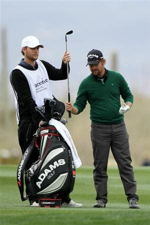MARANA, AZ - FEBRUARY 26:  Ryan Moore (R) pulls a club alongside caddie Jason Moore (L) on the 13th hole during the quarterfinal round of the Accenture Match Play Championship at the Ritz-Carlton Golf Club on February 26, 2011 in Marana, Arizona.  (Photo by Andy Lyons/Getty Images)