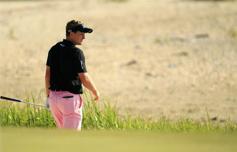 HILTON HEAD ISLAND, SC - APRIL 24:  Luke Donald of England helps look for the ball of Jim Furyk on the 18th hole during the final round of The Heritage at Harbour Town Golf Links on April 24, 2011 in Hilton Head Island, South Carolina.  (Photo by Streeter Lecka/Getty Images)