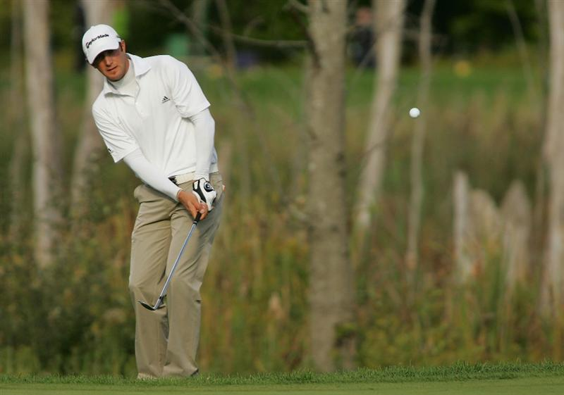 VERONA, NY - OCTOBER 05: Dustin Johnson plays his third shot on the 15th hole during the final round of the Turning Stone Resort Championship at Atunyote Golf Club held on October 5, 2008 in Verona, New York. (Photo by Michael Cohen/Getty Images)
