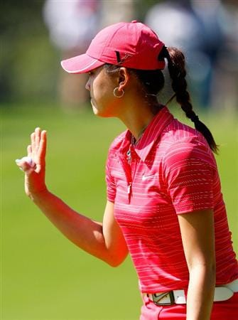GUADALAJARA, MEXICO - NOVEMBER 15:  Michelle Wie of the United States reacts after her birdie putt on the third green during the final round of the Lorena Ochoa Invitational Presented by Banamex and Corona at Guadalajara Country Club on November 15, 2009 in Guadalajara, Mexico.  (Photo by Kevin C. Cox/Getty Images)