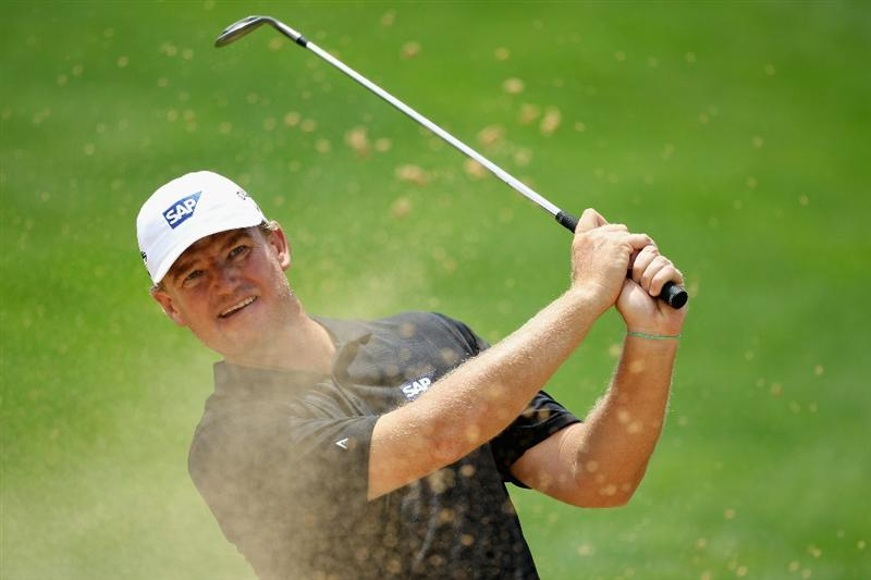 SUN CITY, SOUTH AFRICA - DECEMBER 01:  Ernie Els of South Africa plays out of the ninth greenside bunker during the pro-am for the 2010 Nedbank Golf Challenge at the Gary Player Country Club Course  on December 1, 2010 in Sun City, South Africa.  (Photo by Warren Little/Getty Images)