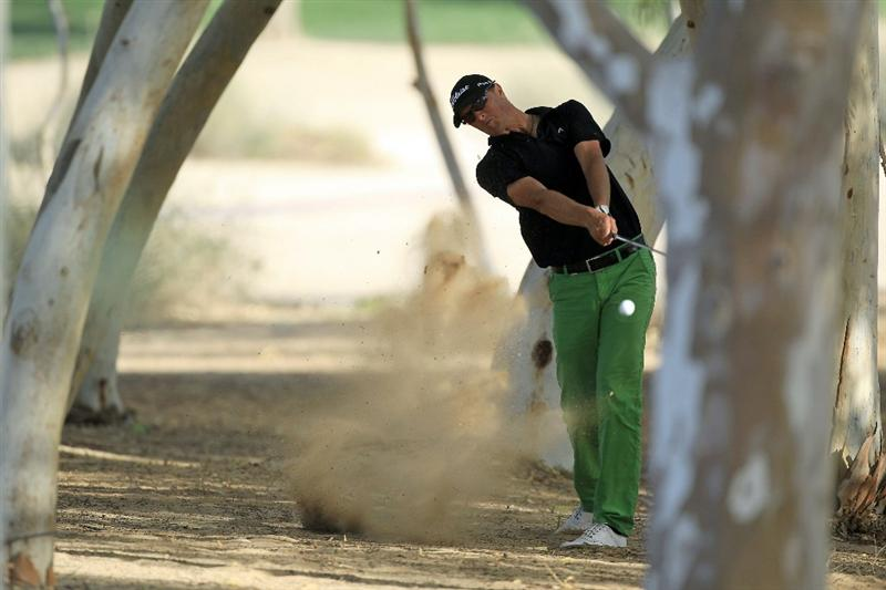 DUBAI, UNITED ARAB EMIRATES - FEBRUARY 13:  Fredrik Andersson Hed of Sweden plays his second shot at the 18th hole during the final round of the 2011 Omega Dubai Desert Classic on the Majilis Course at the Emirates Golf Club on February 13, 2011 in Dubai, United Arab Emirates.  (Photo by David Cannon/Getty Images)