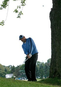 BLOOMFIELD HILLS, MI - AUGUST 10:  Ben Curtis plays his third shot on the 11th hole during the final round of the 90th PGA Championship at Oakland Hills Country Club on August 10, 2008 in Bloomfield Township, Michigan.  (Photo by Hunter Martin/Getty Images)