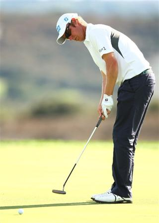 MADRID, SPAIN - OCTOBER 11:  Mikko Ilonen of Finland in action during the Final Round of the Madrid Masters at Cantro Nacional De Golf on October 9, 2009 in Madrid, Spain.  (Photo by Ian Walton/Getty Images)