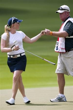 CHON BURI, THAILAND - FEBRUARY 17:  Morgan Pressel of USA celebrates with her caddie on 15th green during day one of the LPGA Thailand at Siam Country Club on February 17, 2011 in Chon Buri, Thailand.  (Photo by Victor Fraile/Getty Images)