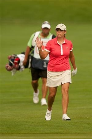 SPRINGFIELD, IL - JUNE 14: Cristie Kerr waves to the gallery on the 18th hole during the continuation of the final round of the LPGA State Farm Classic at Panther Creek Country Club on June 14, 2010 in Springfield, Illinois. (Photo by Darren Carroll/Getty Images)